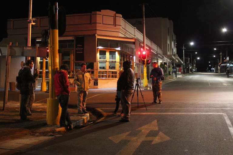 Photographs standing at street conrner intersection outside Studio Gesso